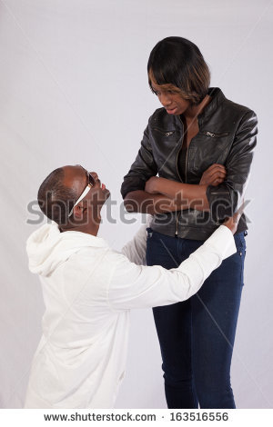 stock-photo-black-couple-with-the-man-kneeling-before-the-woman-and-pleading-with-her-a-relational-inequality-163516556